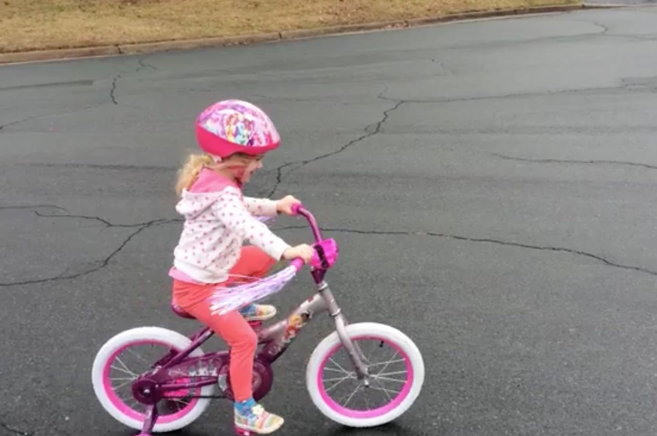 daughter riding princess bike