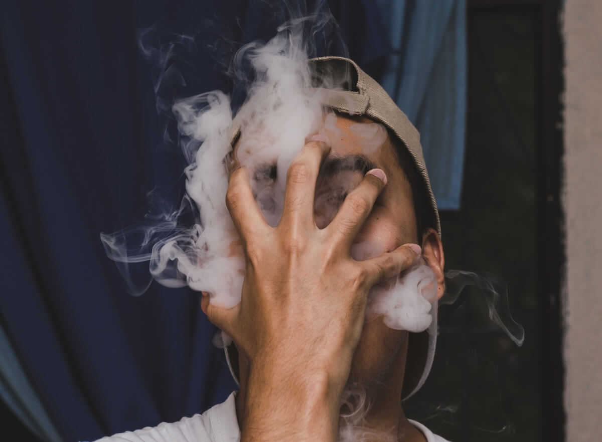 Photo of smoking coming out of a man's face by Ricardo Mancía on Unsplash