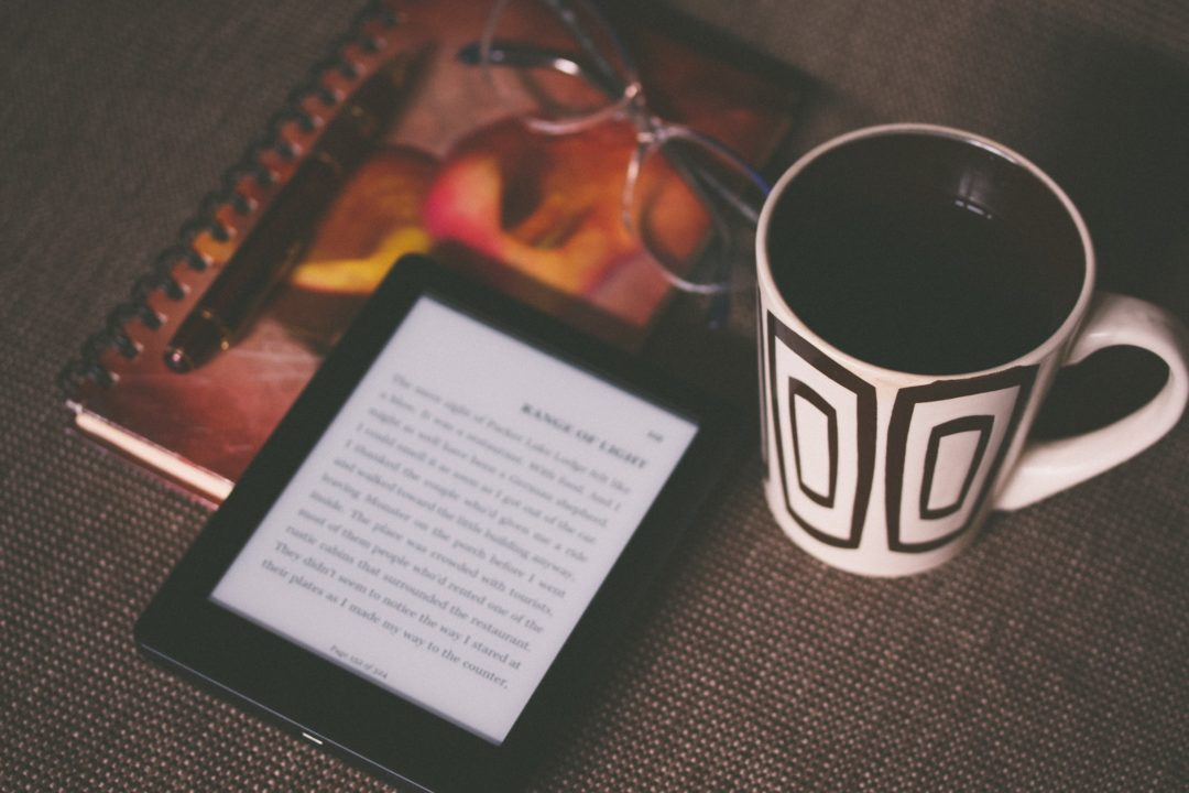 kindle ebook and a cup of coffee